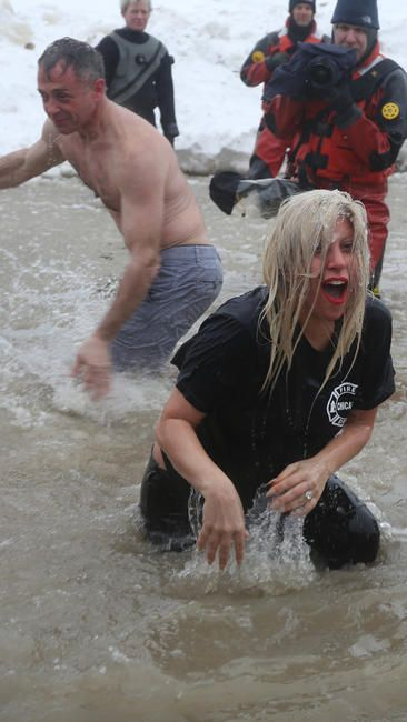 "Cold charity - Actor David Eigenberg of ""Chicago Fire,"" left, and Lady Gaga emerge from the icy waters of Lake Michigan during the annual Polar Plunge on March 1, 2015"