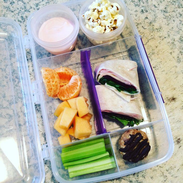 Lunch box idea : Berry yoghurt  Home popped popcorn  Mandarin  Rock melon  Celery sticks  Ham & salad wrap  Homemade no bake cookie