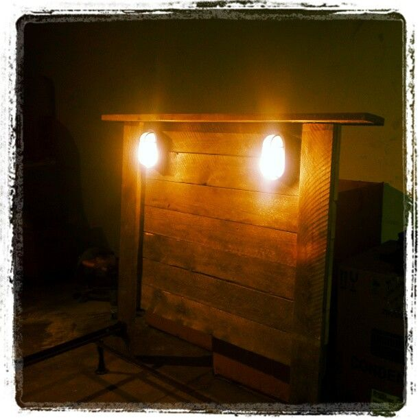 Headboard made from wooden pallets. Wired exterior lights from ...