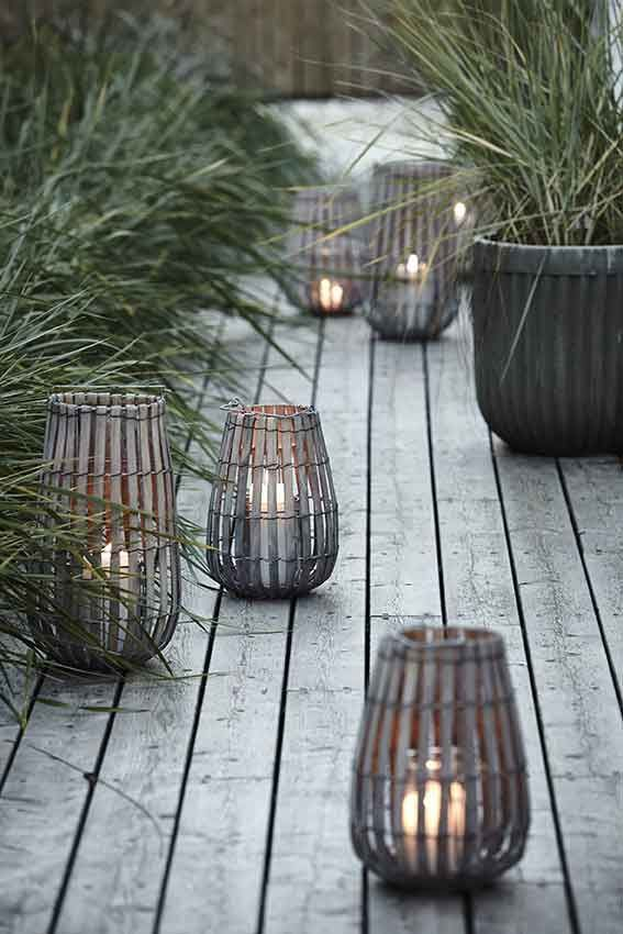 Beautiful rattan lanterns with candles. Love this beach look, but it's definitely a fire hazard. Light them with Mirage or Candle Impressions outdoor LED candles.