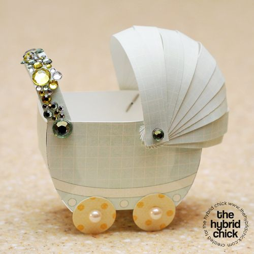 Paper Pram's filled with candy for baby shower favors. http://www.thehybridchick.com/2011/04/baby-shower-paper-pram/