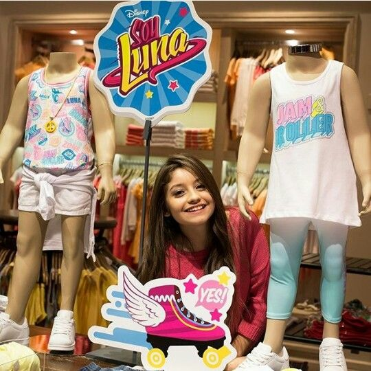 Karol Sevilla at a shop with Soy Luna Clothes