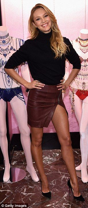 Saucy split: For her in-store appearance, the blonde model donned a wine red leather skirt...