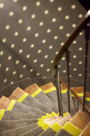 maybe somethin like this for the carpet runner? only widened to the outer edges of the stairwell? Solid color at edges and patern in the middle? Also - I love this wallpaper.