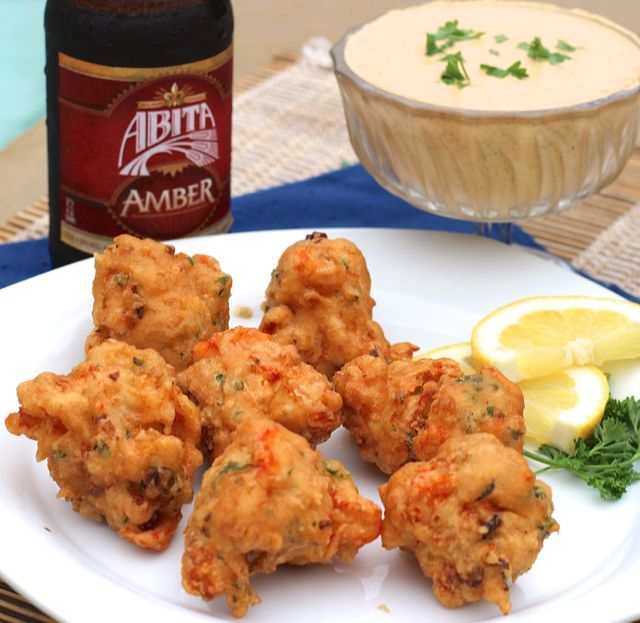 Crispy southern fried Crawfish Beignets with spicy Remoulade Sauce, a savory version of a Louisiana classic.