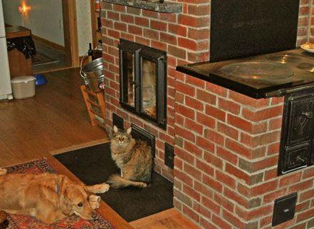 pets enjoying the wood burning heater