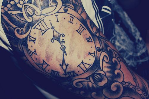 clock tattoo. Pretty design, would like to see it in color.
