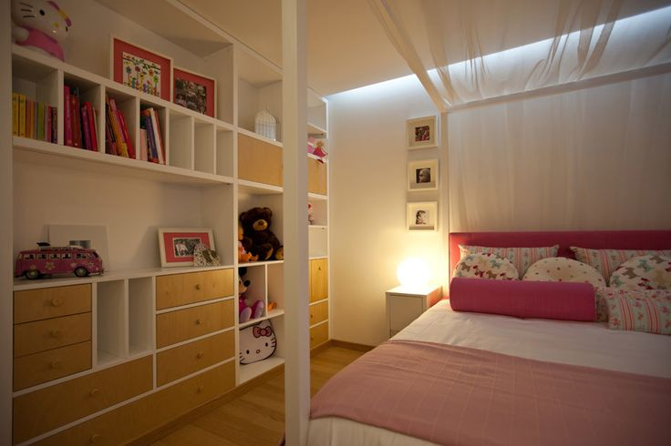 girl's bedroom | canopy bed | pink and white | eams chair | suspensed lamp | bookcases