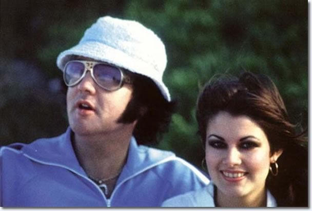 Elvis is killing it with that hat and those shades.