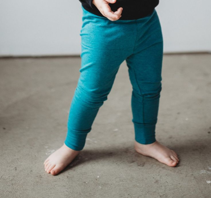 Comfortable and cozy with elastic waist and ankle cuffs. These leggings are a teal melange, with hints of black.