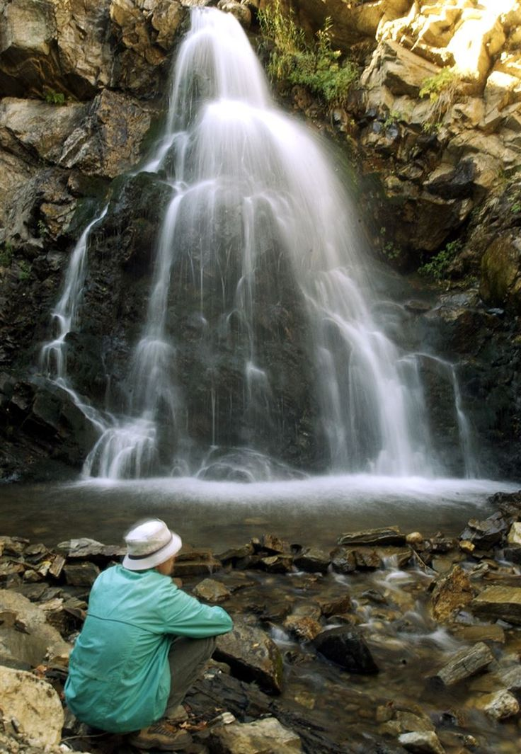 PHOTO BY BRIAN NICHOLSON--------Boy Scout leader Adon Crook of Kaysville relaxes near a waterfall below the Sunset Campground in Farmington Canyon. Standard-Examiner file photo.