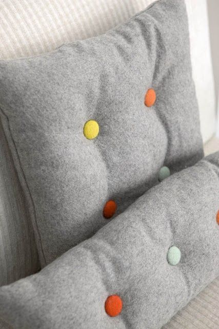 Grey Pillows with yellow and white buttons