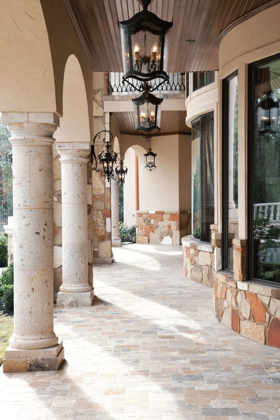Architectural elements abound in the home's exterior spaces. Gentle arches, stone pillars and custom lighting add interest on the lanai.