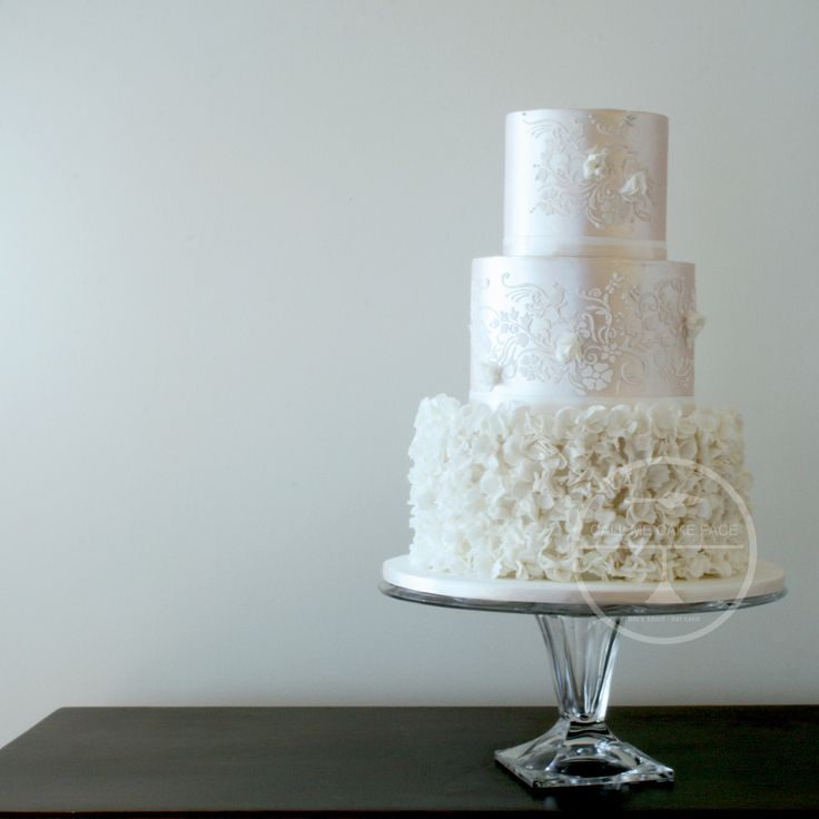 Pale pink pearl lustre with a bottom tier of hundreds white sugar blossoms.