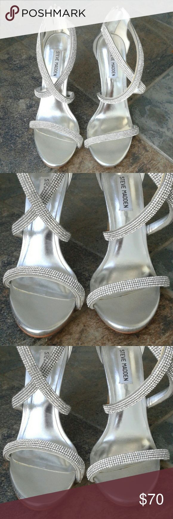 """Steve Madden Silver Strappy Sandals Size 8M Steve Madden Metallic Silver Rhinestone Sandals Style #: Finaa Fabric and PU Upper Man Made Lining Fabric Coated Sole  Open Toe Multi Rhinestone Strap Construction Metallic Finish Back Zip Closure Lightly Padded Insole Covered Stiletto Heel 4.25"""" heel  Perfect go-to sandal for any event! Steve Madden Shoes Sandals"""