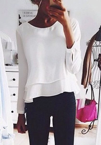 Another great addition to your wardrobe is this pretty white layered chiffon blouse. It has a loose fit and laid-back style, a crew neckline and a sexy keyhole back. Only here. | Lookbook Store Tops