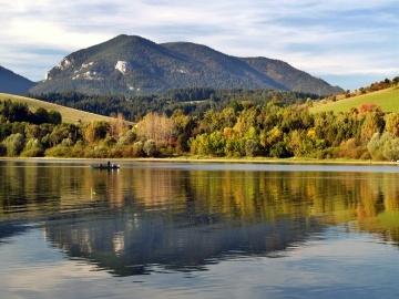 Reflection of mountain in a deep Liptovska mara lake, Slovakia.