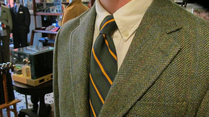 Tweed sport coat, ecru OCBD, green tie with yellow & navy stripes