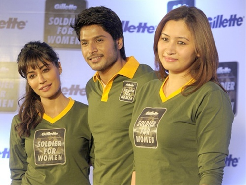 """Actress Chitrangada Singh, actor Sundeep Kishan and badminton player Jwala Gutta pose at a """"Soldier for Women"""" promotional campaign in Hyderabad."""