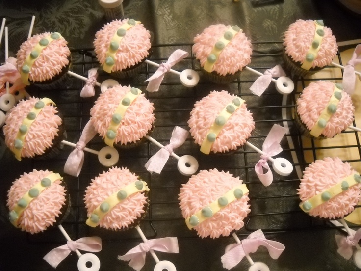 Baby rattle cupcakes. Great idea for a shower