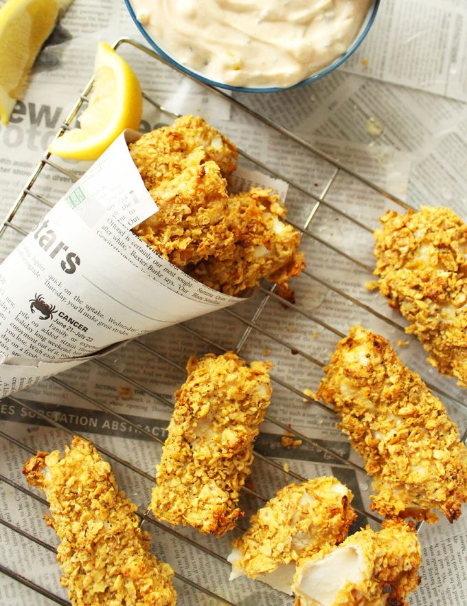 Crispy Baked Fish Sticks with Greek Yogurt Tartar || Healthy, baked fish sticks coated with a light but crispy layer of crushed up Cracker Chips. Serve with some homemade Greek yogurt-based tartar sauce for the ultimate weeknight meal!