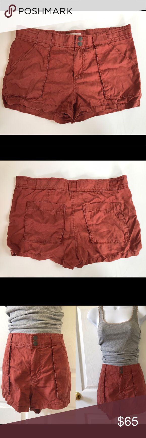 """Free People Rustic Orange Red Military Shorts Super cute lightweight Rustic orange/ red military shorts by free People. Though the style is meant to be somewhat distressed looking, there are some minor signs of wear. However, they are invisible unless you're looking for them. See pictures. These are in great shape and have so much life left I them. And they're lightweight which makes them perfect for summer. No rips, stains, tears, imperfections really,etc. 100% tencel.  Waist: 17.5"""" Rise…"""