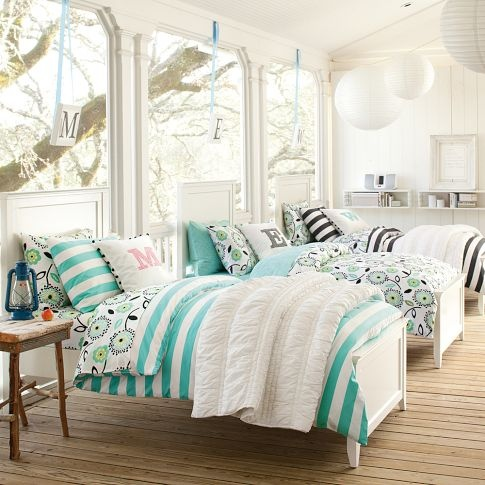 I like the mix and match of the 3 sheets and comforters. I also like the pillows with the initials (which would be easy to DIY).