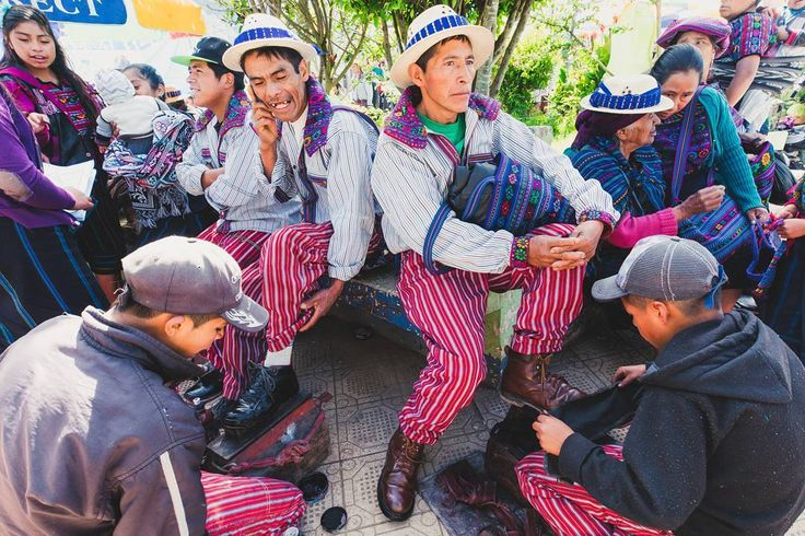 Hombres of Todos Santos Cuchumatan get their shoes shined on market morning. The outfits aren't for a special occasion; this is how the menfolk of this remote mountain town dress everyday. // #alaskatoargentina #bicycletouring #bikepacking #cyclinglife #exploretheworld #theglobewanderer #igtravel #roamtheplanet #staywild #travelphotography #getlost #explorer #optoutside #keepexploring  #exploretocreate #travelphoto #passionpassport #lifeofadventure #intothewild #travelphotograper…