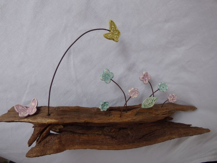 Blue and Pink impressed clay flowers on New Forest wood stand by SharwoodDecor on Etsy https://www.etsy.com/uk/listing/469887381/blue-and-pink-impressed-clay-flowers-on