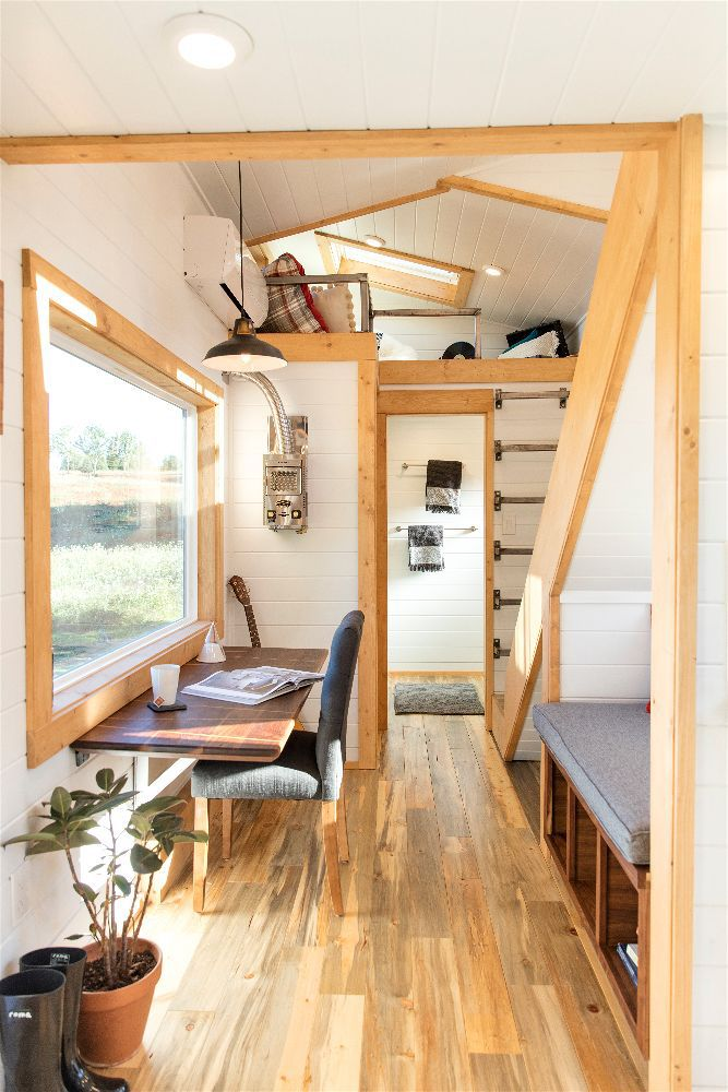 The tiny house has a master bedroom loft for the couple and a guest loft space for when their sons visit.