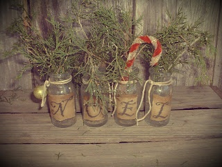 lovely.  simple. old jars and sweet annie with candy cane