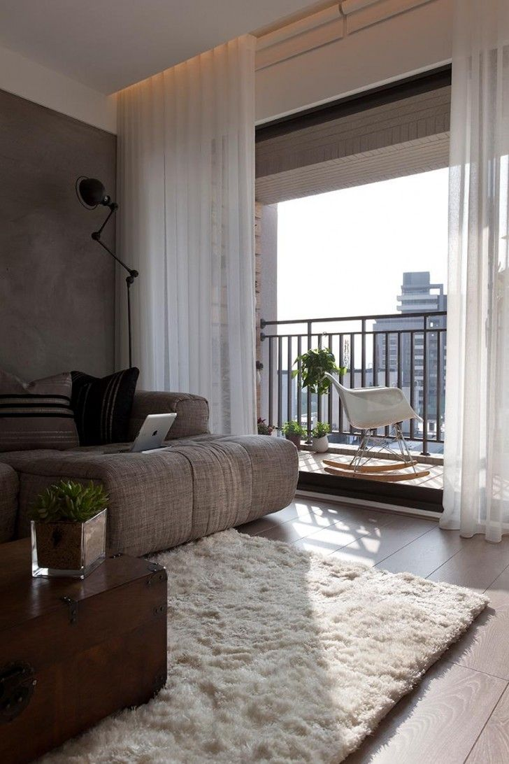 Interior Design, White Fur Rug Balcony Dark Gray Sectional Sofa Brown  Wooden Coffee Table White
