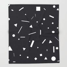 white shapes on black throw blanket
