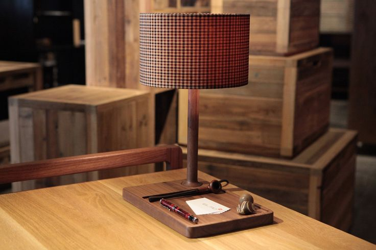 NEATO is a solid walnut table lamp whose base is a tray to help one stay organized. (Designer: Giordano Caldarini for Elmo, Ltd. in Hong Kong)