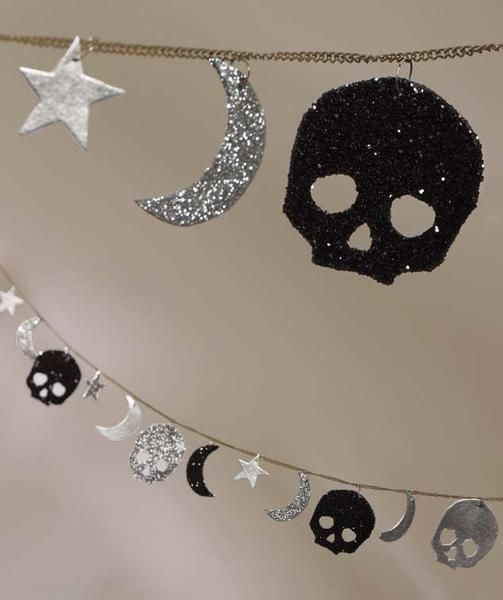 Spooky glittered moon, stars and skull Halloween garland.