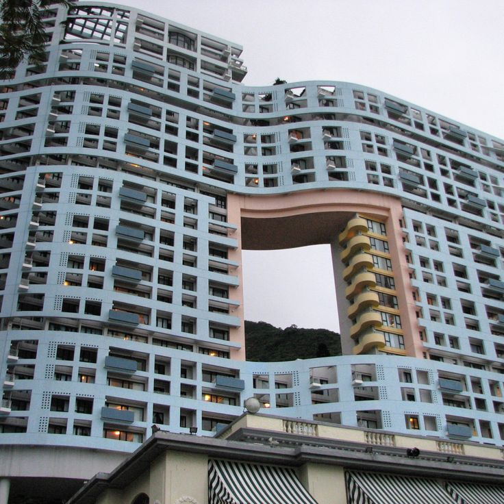 Repulse Bay, Hong Kong, 1989. The hole is so the building doesn't block the dragon living in the hills from the sea.  http://thetriumphofpostmodernism.tumblr.com