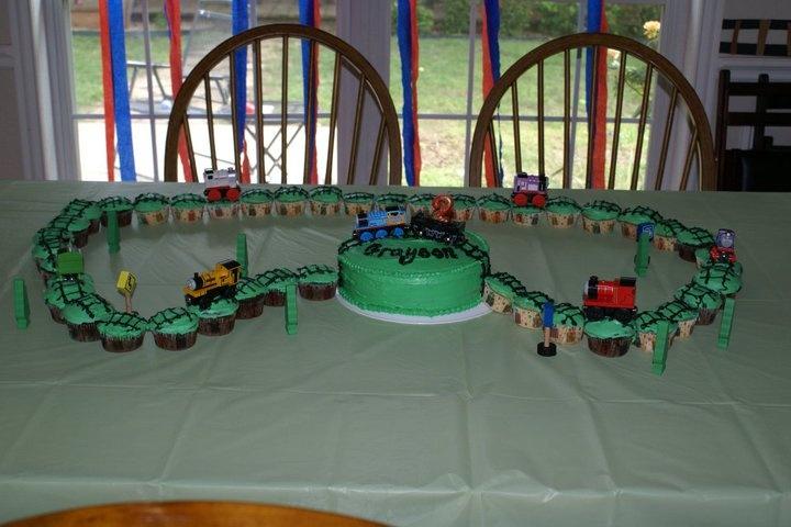 Train birthday cake with cupcakes