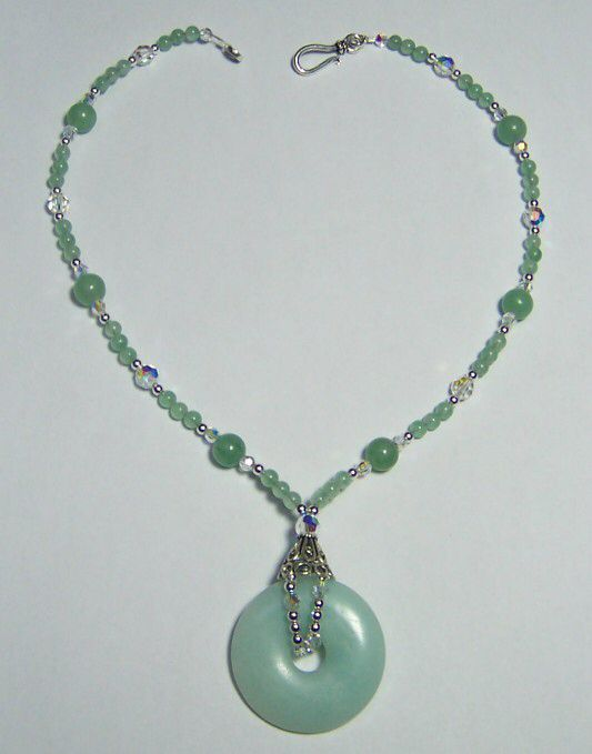 Image from http://www.rubymooncreations.net/store/images/GREEN%20JADE%20DONUT%20NECKLACE2.jpg.