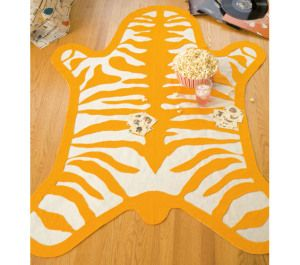 Here is a PDF pattern and directions to make a pop art inspired felt zebra-skin rug.