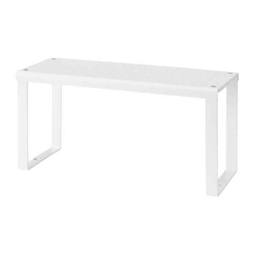 Use to add height to your table display. Also available in an add on size for two heights. From IKEA.  VARIERA Shelf insert, white