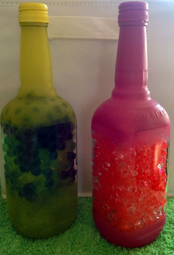 Some new bottle vases in the making, filled with Jelly Balls for longer lasting flowers.