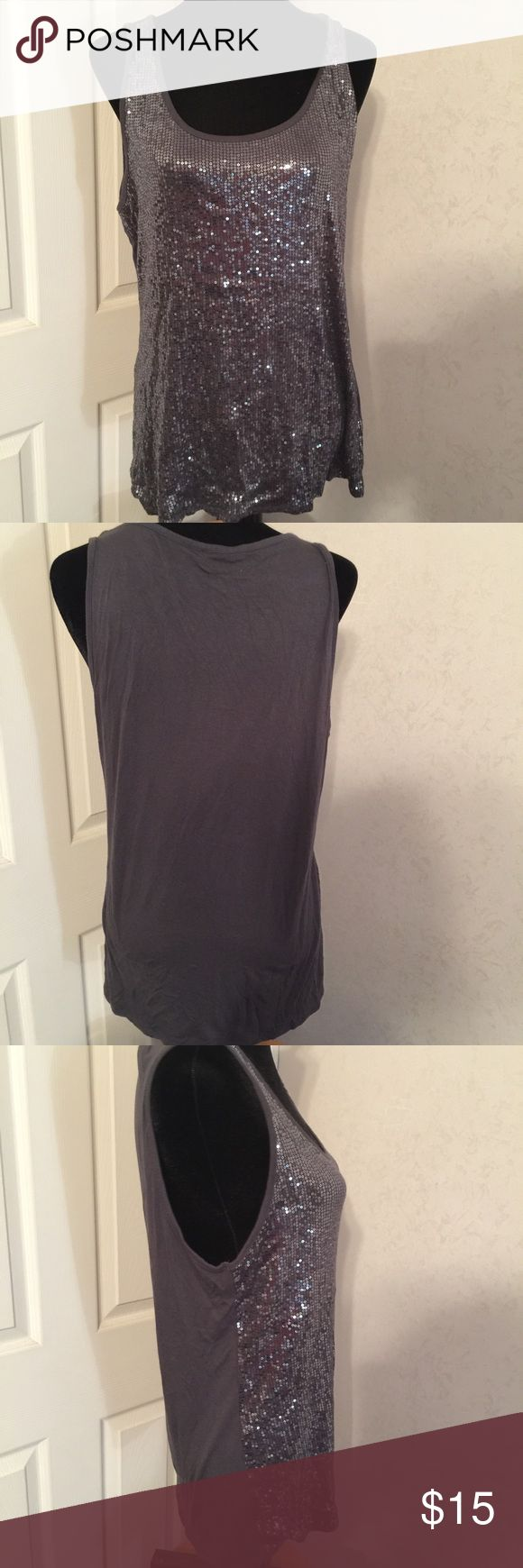 Maurice's gray sequin tank top size XXL. Maurice's gray sequin tank top size XXL. This is a great tank with sequin front and solid gray back in great shape. Please view all pictures. Maurices Tops Tank Tops