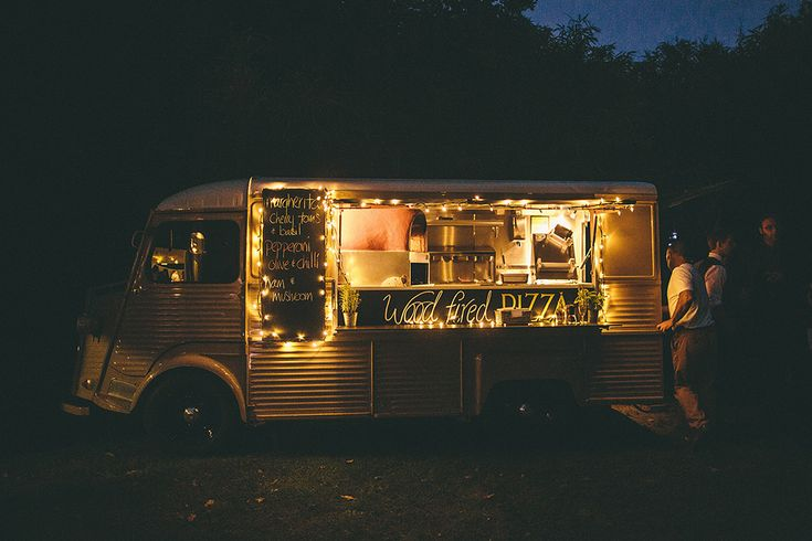 Wood Fire Pizza Van - Image by Jason Mark Harris Photography - Bride wears a lace Maggie Sottero Dress at a rustic wedding in a marquee on the Isle of Wight. Bridesmaids wear different beaded vintage dresses and guests enjoy a pizza van & pop up bar in the evening.