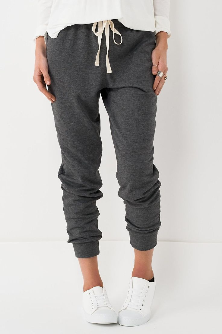 Who doesn't like super soft comfortable sweats?! These pants feature a cream cinch waist drawstring and hem ankles. 62% Polyester. 36% Rayon. 2% Spandex. Hand wash cold, line dry.