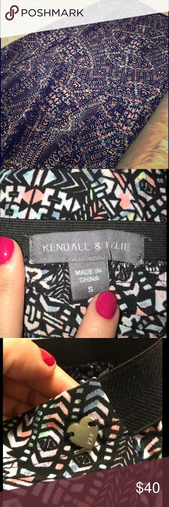 Kendall & Kylie Double-Slit Skirt Kendall & Kylie Double-Slit Skirt. Tribal-inspired with gorgeous neons and black and white accents. Perfect for a festival/beach party and wanting to stand out! Elastic band and very comfortable! Make an offer! Never worn! Kendall & Kylie Skirts Maxi