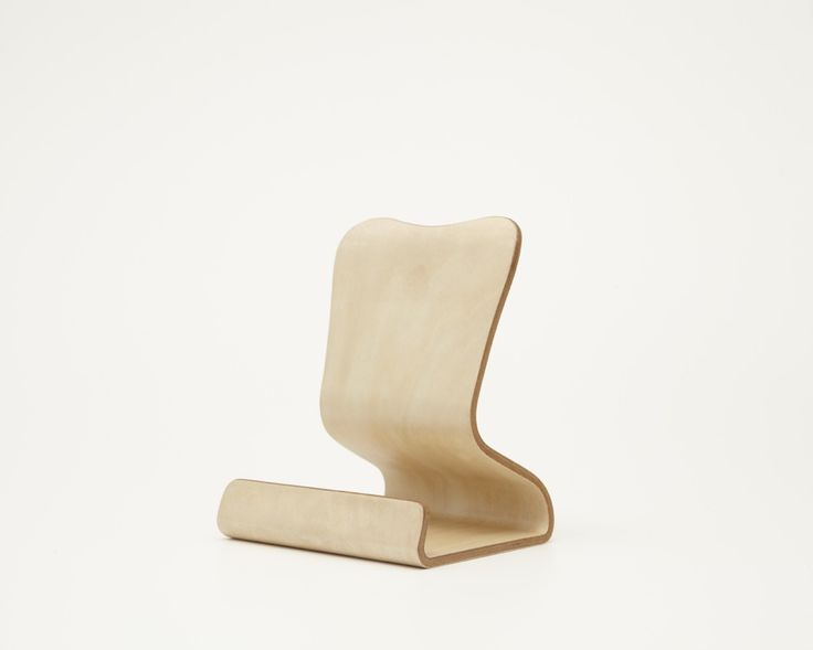 Desktop Chair is a minimalist design created by Japan-based designer Atelier MOKU. This is their first project, and it was released onto Campfire, Japan's version of Kickstarter. The stand is completely handmade using fine natural basswood. The stand essentially turns the Macbook into a desktop machine with an external display. (8)