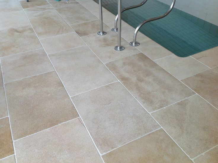 Beige stone tiles for inside and outside. Faringdon stone tiles have a Cotswold limestone tone but are much more durable.  http://www.naturalstoneconsulting.co.uk/limestone-faringdon-limestone-flooring-