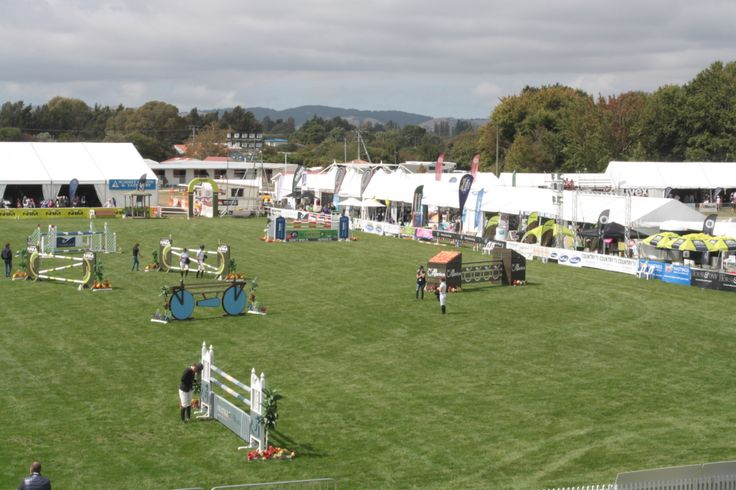 Competitors in the Norwood Gold Cup walk the course in the Land Rover Premier Arena today