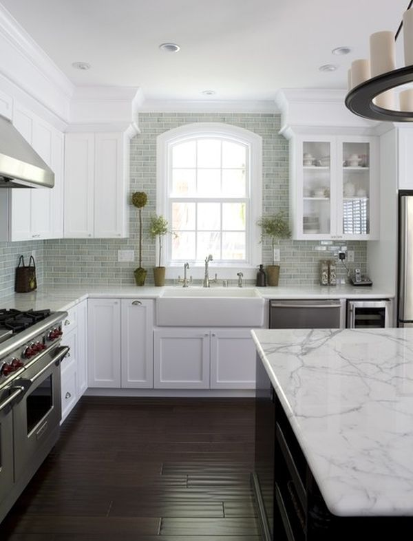 Idea - leave our white cabinets, with our dark wood floor (looks just like the one in this pic,) remove the wallpaper and add this beautiful tile backsplash.