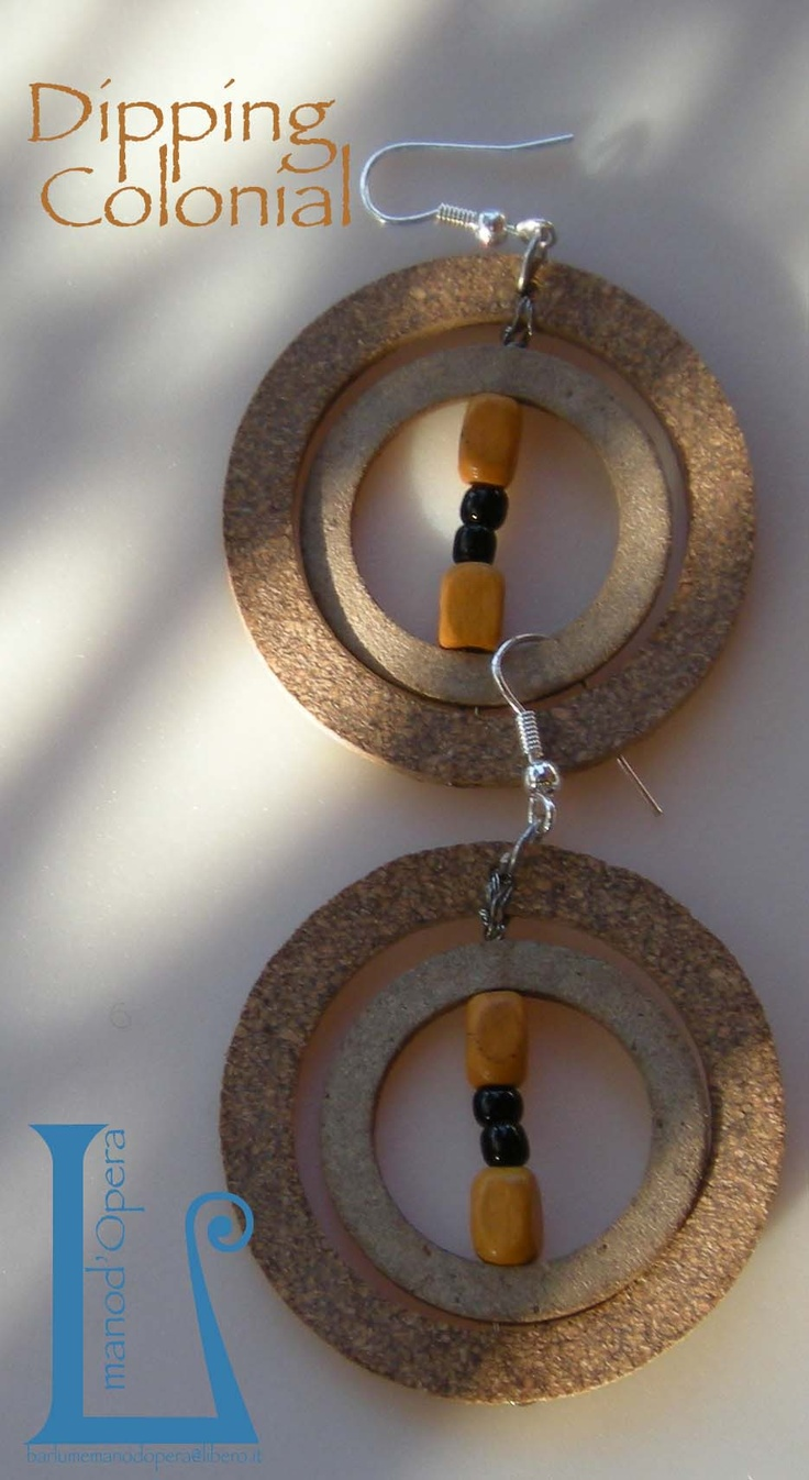 Hydraulic seals,wooden beads and glass.Handmade by BarlumeManod'Opera.